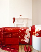 Double bed with red blanket and bed spread