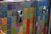 Multicoloured terracotta tiles in bathroom