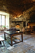 Rustic kitchen within the sandstone walls of historical Chateau de Cassaigne