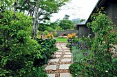 Garden path made of gravel & stone flags