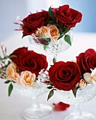 Roses in crystal dishes as table decorations