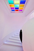 Spherical installation and square ceiling lamp with coloured glass elements in modern stairwell