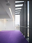 Empty room with purple carpet in contemporary building