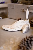 Old shoe last used as candlestick and Christmas decoration