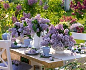Table laid out side decorated with lilacs