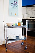 Trolley with dishes in modern kitchen