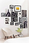 Retro armchair upholstered with white fur fabric below collage of black and white photographs and lettered artworks on wall