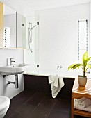 White bathroom with black slate flags