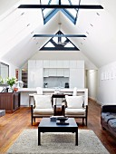 Open-plan interior with lounge, dining area, kitchen & various window elements in gable ceiling