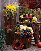 Autumn flowers in rusty vases