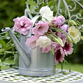 Summer bouquet in watering can