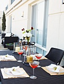 Cocktail and Place Settings on a Rooftop Patio Table