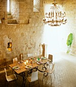 Set dining table in tower interior in Chateau Maignaut (Pyrenees, France)