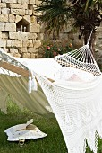 White hammock in garden of Château Maignaut (Pyrenees, France)