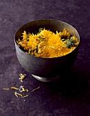 Bowl of dandelion flowers