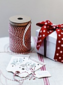 Festive gift tags, ribbon and gift box