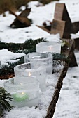Ice tealight holders in snow