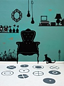Playful wall design with 50s silhouette-style elements in black vinyl paint and white floor with pattern of grey circles