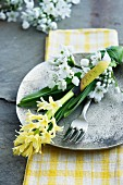 Place setting with hyacinth, white allium and name card