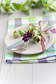 Spring table setting with hyacinth florets and hellebores