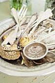 Old silverware; tea strainer, spoons, forks etc.