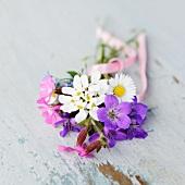 Posy of garden flowers on vintage shelf