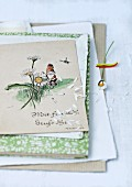 Vintage postcards and daisy petals
