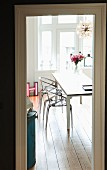 Plexiglass chairs at dining table in renovated period building