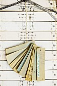 Punched pattern cards and ribbon samples hanging from string