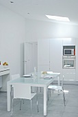 Minimalist white kitchen - all materials are white or made of glass