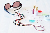 Home-made jewellery; glasses chain made from rocailles beads of various sizes, silver foil beads, old cubic beads from flea market and jewellers' wire