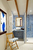 Attic bathroom with tiled shower area