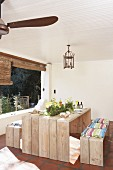 Spring arrangement on rustic outdoor table and wooden benches in loggia