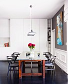 Dark wood, classic chairs at dining table in modern kitchen with traditional ambiance