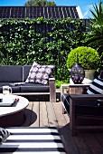 Comfortable garden furniture on wooden terrace in urban surroundings
