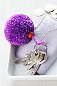 Keys with pompom on key ring