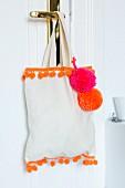 Cloth bag decorated with pompons & pompom trim