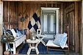 Cosy, maritime decor in porch of wooden house