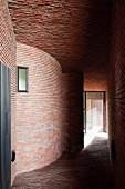 Narrow corridor between brick houses