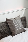 Soft, luxurious guest bed with faux fur and patterned silk scatter cushions