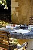 Book on stone-topped table on terrace