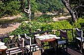 Set table on restaurant terrace with view of river landscape