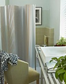 Modern bathroom with Retro armchair and metal screen