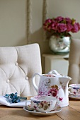 Floral tea set, linen napkin and beaded napkin ring