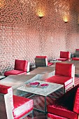 Devi Ratn Hotel - monolithic furnishings with red cushions in lobby