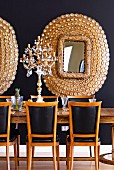 Elegant dining area with classic, leather covered chairs, crystal candelabra and gilt-framed mirrors