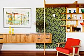 Floating sideboard and open shelving in wall aperture next to patterned panel
