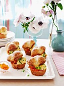 Brioche rolls with scrambled egg and smoked trout