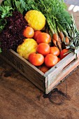 Vegetables and lemons in vintage wooden crate
