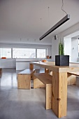 Minimalist wooden table and benches in modern interior
